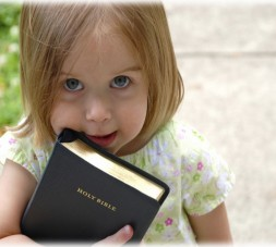 This little one picked up her dad's Bible on the way out of church.